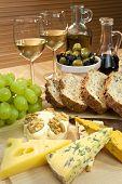 Mediterranean Diet Of Cheese, Wine, Grapes, Olives, Bread Balsmaic Vinegar