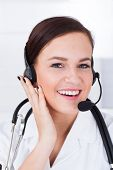 Confident Female Doctor Wearing Headset