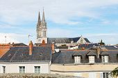 foto of anjou  - tower of Saint Maurice Cathedral and roofs of houses in Angers city France - JPG