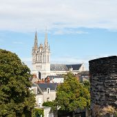 image of anjou  - skyline with Saint Maurice Cathedral and wall of Angers Castle France - JPG