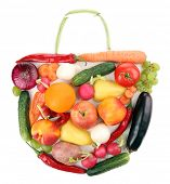 Fresh organic vegetables and fruits in shape of bag, isolated on white