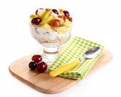 Healthy breakfast - yogurt with  fresh grape and apple slices and muesli served in glass bowl on woo