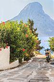 Scooter on narrow Greek Kalymnos island street