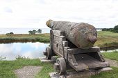 stock photo of contactor  - Old cannon to defend the castle towards the ocean - JPG