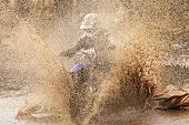 picture of motocross  - Motocross racer in a wet and muddy terrain in Parola Finland - JPG