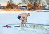 adult man swimming  cold water