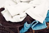 Laundry. Wicker basket with dirty towels