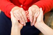 picture of geriatric  - Young carer giving helping hands for elderly woman - JPG