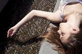 Laying Touching Water
