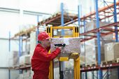 picture of factory-worker  - Worker with bar code reader working in warehouse  - JPG