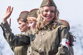Truck with girls in uniform of times WW2 on parade