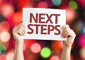 Next Steps card with colorful background with defocused lights