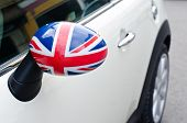 Close up on a side mirror of a car with the UK flag on it.