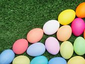 Easter symbols on green grass