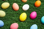 Coloured Easter eggs in green grass