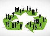 Business people standing on a symbol of recycling.