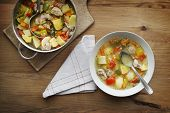 stock photo of stew  - Served warm stew with vegetables and meat on the plate - JPG