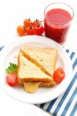 Sandwiches with cheese and tomatoes on plate near glass of tomato juice isolated on white