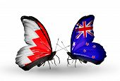 Two Butterflies With Flags On Wings As Symbol Of Relations Bahrain And New Zealand