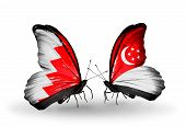 Two Butterflies With Flags On Wings As Symbol Of Relations Bahrain And Singapore
