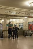 Police Officers Assist Tourist At Grand Cetral Terminal