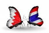 Two Butterflies With Flags On Wings As Symbol Of Relations Bahrain And Thailand