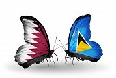Two Butterflies With Flags On Wings As Symbol Of Relations Qatar And Saint Lucia