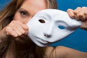 pic of female mask  - angry female face semi covered with white mask - JPG