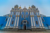 St. Michael's Cathedral. Orthodox church with blue walls and golden domes, white columns. Kiev, Ukra
