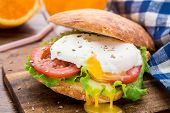 Burger with pouched egg and tomato