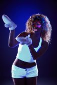 Curly model in warm gloves under UV light
