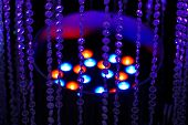 Abstract Background With Curtain Of Beads And Colored Lights