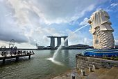 Merlion Statue And Marina Bay Sands Building In Singapore