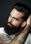 stock photo of hooligans  - Portrait of a handsome hipster guy with beautiful beard - JPG