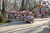 Ashgabat, Turkmenistan - Circa December 2014: Colorful Train Transporting Children With Parents In T