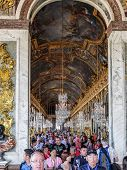 VERSAILLES, FRANCE - AUGUST 28 2013: Versailles, crowds of tourists visiting Palace of Versailles, Hall of Mirrors