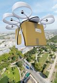 3D rendering of a commercial drone carrying a box flying above a city center
