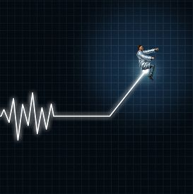 picture of flatline  - Medical health concept as a physician or researcher guiding and managing an ecg or ekg monitor light out of flat line danger - JPG