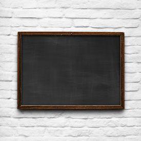 stock photo of chalkboard  - School chalkboard with vintage grungy wood frame - JPG