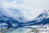 foto of mountain-range  - beautiful mountain lake at the foot of the mountain - JPG