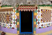 foto of threshing  - Traditionally decorated hut in the tribal village on the desert in India in the Gujarat state - JPG