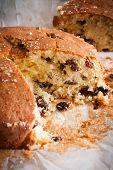 image of sponge-cake  - Traditionally home baked farmhouse sultana or dried fruit light sponge cake with a slice removed - JPG
