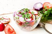 picture of chinese parsley  - Spring salad with radishes cucumber Chinese cabbage and red onion closeup in glass bowl on a white wooden background - JPG