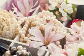 foto of mother-of-pearl  - apple tree and magnolia fresh flowers with pearls and vintage lace - JPG