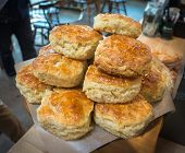 picture of maple syrup  - plate of delicious  fresh baked biscuits with maple syrup on top - JPG