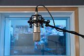 pic of condensation  - Professional condenser microphone in recording studio interior - JPG