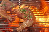 picture of roast chicken  - Barbecue Roast And Smoked Chicken Quarters On The Hot Flaming Charcoal Grill Background - JPG
