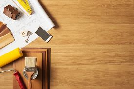 foto of reconstruction  - Do it yourself home remodeling and renovation concept work table top view with copyspace and tools top view - JPG