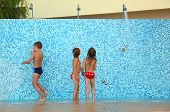 Little Brother And Two Sisters In Bikinis Taking Shower After Swimming