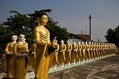 Statue Of Buddha And Disciples Are Alms Round